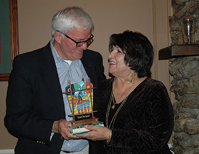 Stanley Keasling presenting Yoneo Ono Award to Anita LaRan.