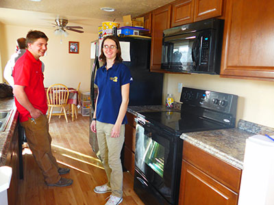 Alex and Angela in remodeled kitchen.