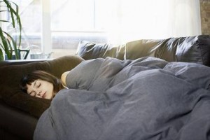 A person sleeping on a couch
