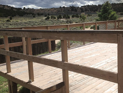 Deck railing before new paint and safety material was added to the sides.