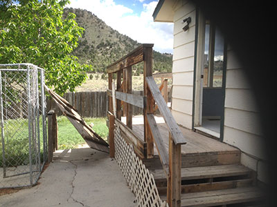 Side porch before repainting.