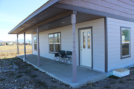 View of north side porch on solar home.