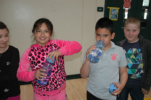 students with their water bottles during the celebration