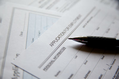 close up employment application and pen