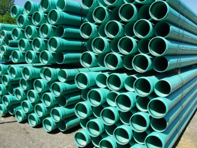 stacked green plastic pipe