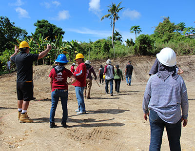 Families getting ready to work on construction site.