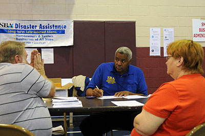 SBA staff member helping clients.