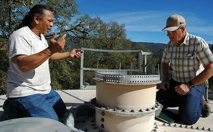 Lee and Santos working on the water tank.