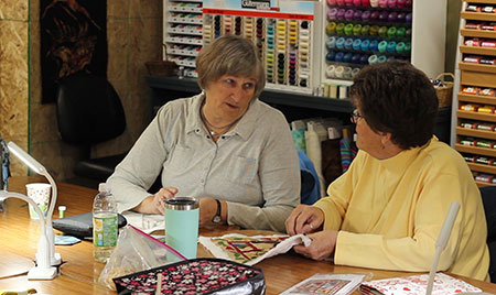 Customers sewing in Sew Pieceful.
