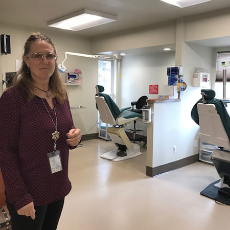 Rhonda Grandi, director of outpatient clinics. Behind her are the dental stations.