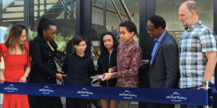 The Puff Factory owner and children cutting the ribbon for the opening.