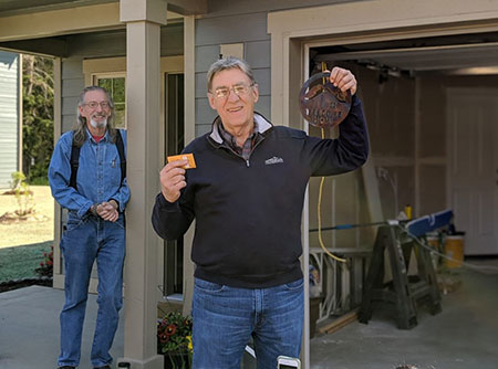 Ted getting keys to his new home