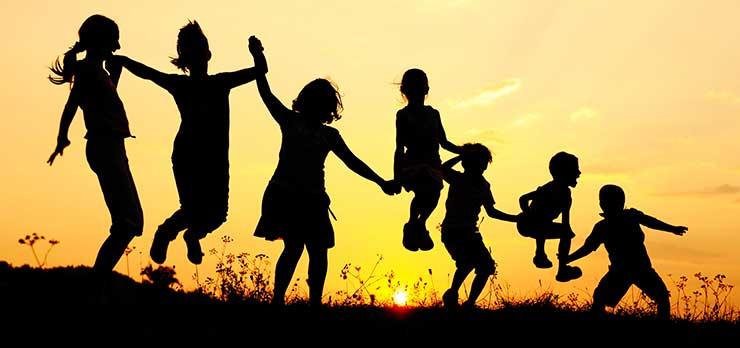 Kids running in the sunset